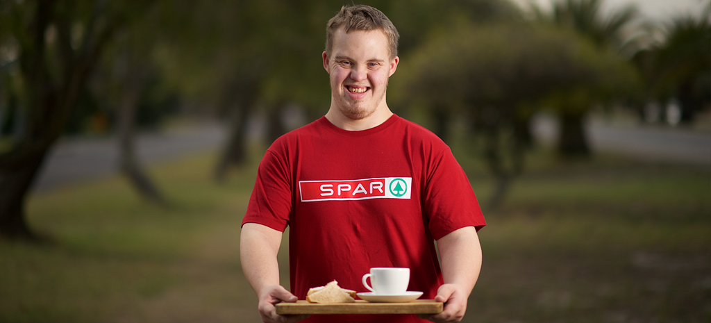 Young adult in red Spar shirt
