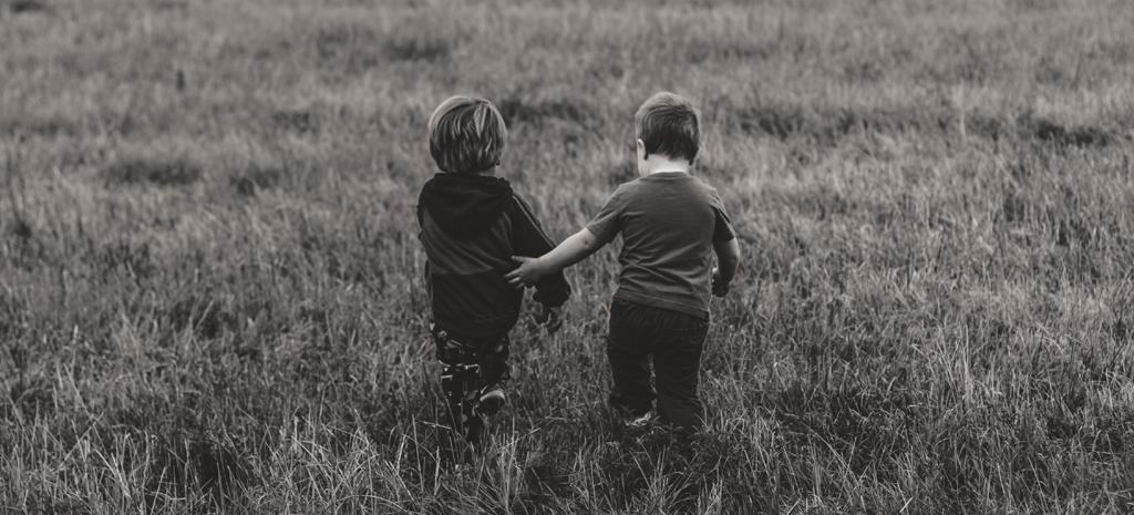 siblings walking